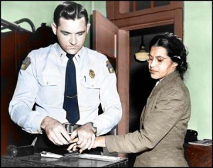 A police officer takes Rosa Parks' fingerprints, 1955